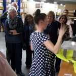 Charlotte shows visitors the dye-sublimation printing process