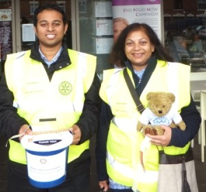 Rotary collectors Jason Chauhan and Sarita Shah... and Sarita's new friend, a teddy in a Rotary vest