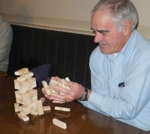 Gone... Peter Mortimer upsets the Jenga tower, but reacts quickly enough to catch most of the bricks