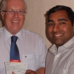 Adrian Walker reeivees a cheque from Dipan Bhagalia