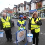 Bert and Diana Thurston brave the elements with Carolyn Robson during the Christmas collection in Queens Road