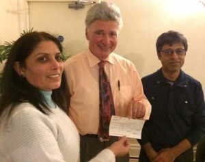 Maya Vansia presents cheque to Roger Neuberg with Deepak Karia