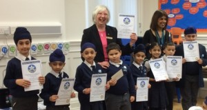 Pam Spokes and Jasbir Mann with the Falcons School winners. Overall winner Marian Bendik in front of Pam