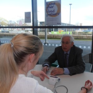 Prof Bert Thurston records the blood pressure of a shopper during Rotary's Know Your Blood Pressure event at Asda, Abbey Lane Leicester