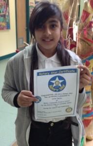 Saha Bachu with her certificate