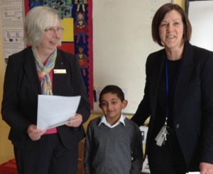 Neil Patel, winner of a £5 voucher and his certificate presented by Pam Spokes (left)