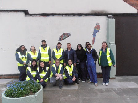Penny Brown, of the city council's parks department, photographed (right) with volunteers at the Walnut Street 'pocket park' before they transformed it ready for a superb Tigers-based mural