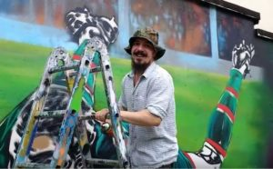 Muralist Leigh Drummond is pleased by the comments he has heard