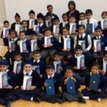 Headteacher Jasbir Mann and Rotary Club Vice President Deepak Karia with children holding the donated tablet PCs. Click on the photo to hear their thanks