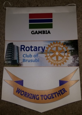 A banner from the new Rotary Club of Brusubi