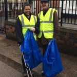 Anoushka Jethwa and Jim Matthews with litter-picker devices