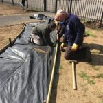 Laying the membrane to keep the new path weed-free