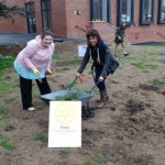 President Gemma Kiddy and Jasbir Mann, headteacher at Falcons Primary School, having fun while working on the Peace Garden