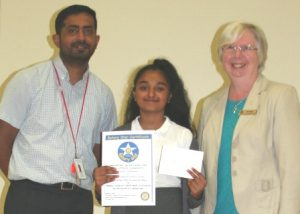 Overall winner Tanicha Vishnukumar with teacher Asif Esat and Rtn Pam Spokes