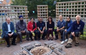 Volunteers with the newly-installed water feature at the Falcons Peace Garden
