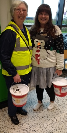 Novus secretary Pam with Immediate Past President Gemma (in the Christmas jumper) collecting