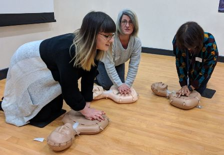 Teaching Assistant Emily York and her mother Tanya, also a TA, learn CPR with headteacher Jasbir Mann