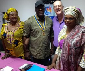 Jim 'Lamin' Matthews with Banki Njie, president of the Rotary Club of Bijilo, with Rotarians Mai (left) and Fatou Bah