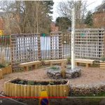 A central feature of the Peace Garden is the Peace Pole and the water feature surrounded by trellises and seats