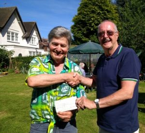 Novus member Jim Matthews (right) presents a cheque for £1637.33 to Rotarian Roger Neuberg for the Rotary Club of Oadby Jaipur Limb appeal