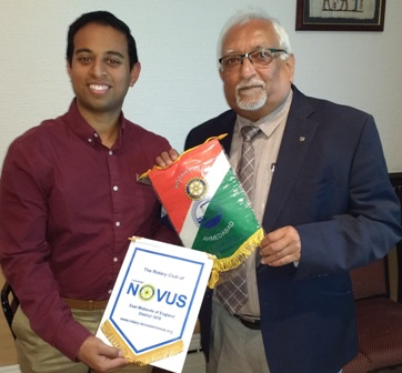 Bannerman times two. President Jason Chuhan exchanges banners with Rotarian Vasant Kalyani