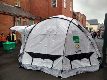 A Shelterbox tent like this can be a temporary home for a family made homeless by a disaster. This one was a gateway to the assembly hall at Falcons Primary School