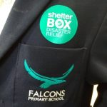 The Shelterbox sticky badge sits beautifully alongside the blazer badge of a Falcons school pupil