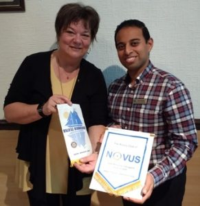 President Jason Chauhan and District Governor Elect Louisa Horne, from Halifax, Nova Scotia, exchange banners