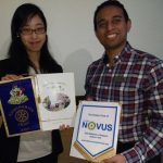 Rotary sponsored scholar Mai Tsumura and President Jason Chauhan with banners
