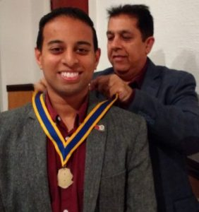 In with the new. President Jason Chauhan receives his president's jewel from outgoing poresident Pradeep Popat