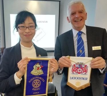 Mai Tsumura prepares to exchange banners with Vice-President Chris Saul