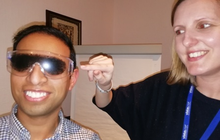 Lucy Slonecki points to the glasses being worn by President Jason Chauhan which replicate the effects of a sight-limiting eye condition