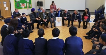 Members of the school council discuss the benefits of the Peace Garden with visting Rotarians. In the background is staff member Emily York who took part in Rotary's Youth Leadership Award scheme