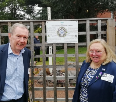 Project leader Frazer Robson with RIBI president Debbie Hodge in front of the trellis for climbing plants