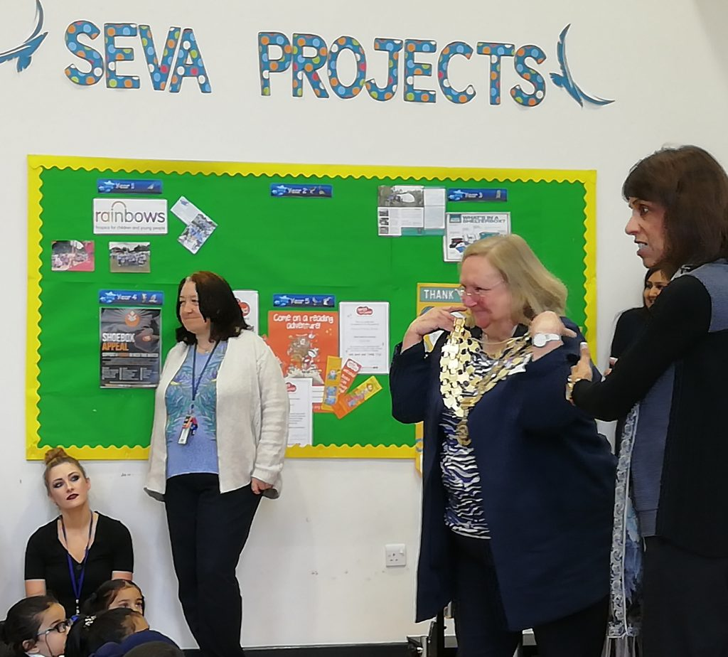 RIBI President Debbie Hodge shows the school assembly her impressive - and heavy - chain of office. Sewa is the Punjabi word for service; a cornerstone of Sikhism and, therefore, of the school