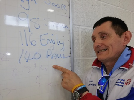 Paul Checkland points to the list of high-scorers, which he topped with a three-dart total of 140