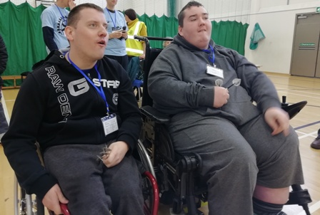 Scott Keating and Calum Smith sit side by side in an early round of the men's darts competition.