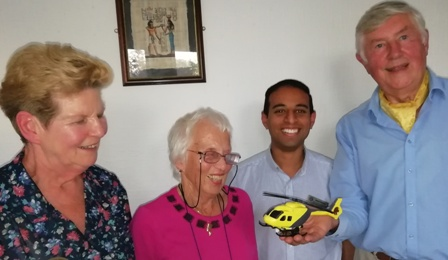 Visitors Sue Lamont and Rachel Kellett, members of Leicester Inner Wheel admire with Presidnet Jason Chauhan the model helciopter held by speaker John Nowell