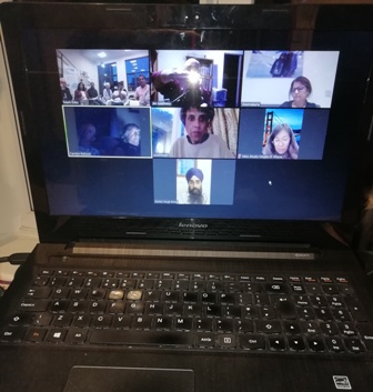 Seven screens with 15 members attending the club's first online meeting