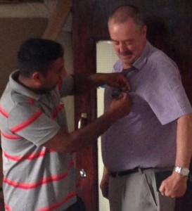 President Dipan gives new member Jim Matthews his Rotary Club of Leicester Novus badge