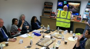 Adrian McGreey shows one version of the personalised high-vis Rotary jackets to his guests