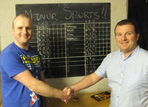 Team captains David Clorley and Paul Moss with the scoreboard