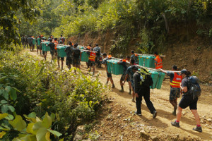 Shelterboxes being carried to the remote areas of Nepal devastated by the earthquake