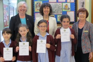 Rotarians Pam Spokes and Diana Thurston flank headteacher Mrs Patricia Mason behind the winning Young Writer pupils from St Thomas More Academy