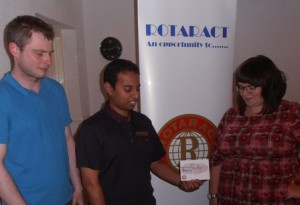 Luc Malherbe, Rotarian Jason Chauhan and president Gemma Kiddy focus on the Rotaract In Business campaign