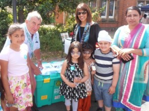 Rotarian Alan Jones shows a Shelterbox to visitors to Falcons Primary School's summer fete