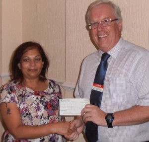Sarita Shah presents a cheque for £51 to Adrian Walker, from LOROS