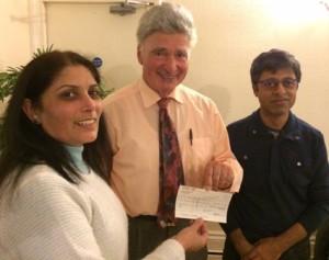 Maya Vansia presents cheque to Roger Neuberg with Deepak Karia