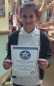 Annya Panhania with her certificate