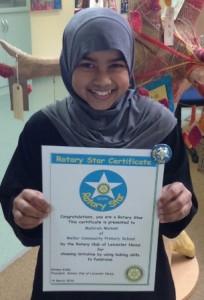 Mahirah Malee with her certificate